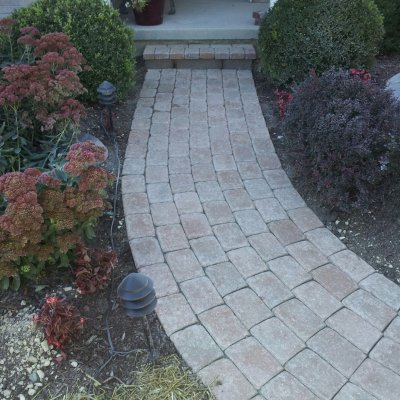 Paver walkway with retaining wall block step